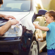 Father with son washing car — Stock Photo #47460951