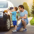 Father with son washing car — Stock Photo #47460979