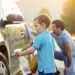 Father with son washing car — Stock Photo #47460981