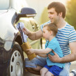 Father with son washing car — Stock Photo #47460997