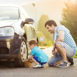 Father with son washing car — Stock Photo #47461039