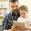 Father and daughter using digital tablet — Stock Photo #47461105