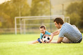 Father with son playing football — Stock Photo