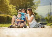 Family on countryside road — Stock Photo