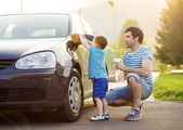 Father with son washing car — Stock Photo