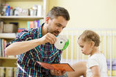 Father showing CD for daughter — Fotografia Stock