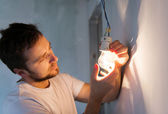 Installing light in a new house — Stock Photo