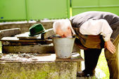 Farmer is washing his face — Stockfoto