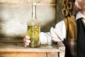 Bottle of herbal spirit — Stock Photo