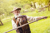 Farmer preparing his scythe — Stock Photo
