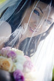 Bride with veil and bouquet — Stock Photo