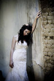 Bride posing by old house — Stock Photo