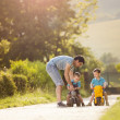 Father with sons playing football — Stock Photo #47909325