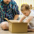 Father and daughter opening box — Stock Photo #47909421