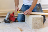 Measuring wood flooring — Stock Photo