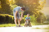 Father with son on motorbike — Stock Photo