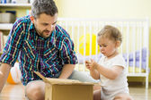 Father and daughter opening box — Stock Photo