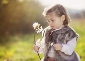 Girl with blooming branch — Stock Photo