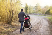 Father with pram during walk — Stok fotoğraf