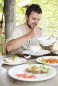 Man in in vietnamese restaurant — Stock Photo