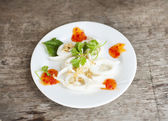 Calamari with coriander — Stock Photo