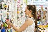 Woman choosing baby stuff — Stockfoto