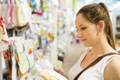 Woman choosing baby stuff — Stock Photo