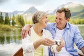Senior couple on boat — Stock Photo
