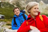 Senior couple hiking at mountains — Stock Photo
