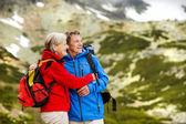 Senior couple hiking at mountains — Foto de Stock