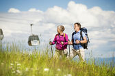 Couple hiking under cableway — Stock Photo