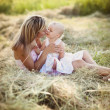 Mother hugging her daughter — Stock Photo #48401595