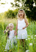 Cute sisters in park — Stock Photo