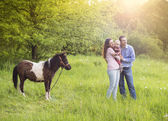 Family with pony — Stock Photo