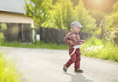 Little boy running on road — Stock Photo