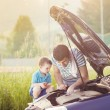 Father with son repairing car — Stock Photo #48497881