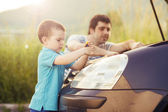 Father with son repairing car — Stock Photo