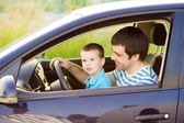 Father with son driving car — Stock Photo