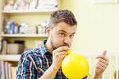 Father is blowing balloon — Stock Photo