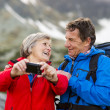 Tourist couple at mountains — Stock Photo #48521269