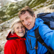Tourist couple at mountains — Stock Photo #48521301