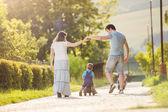 Family in sunny park — Stock Photo