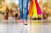 Female legs with shopping bags — Stok fotoğraf
