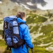 Man hiking at mountains — Stock Photo #49235069