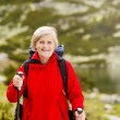Woman hiking at mountains — Stock Photo
