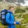 Man hiking at mountains — Stock Photo #49235157