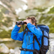 Hiker man with binoculars — Stock Photo #49235209