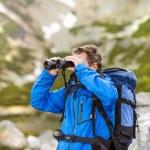Hiker man with binoculars — Stock Photo #49235209