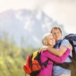 Couple hiking at mountains — Stock Photo #49235521