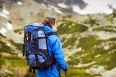 Man hiking at mountains — Stock Photo